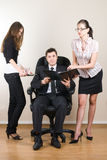Businessman with assistants Royalty Free Stock Photos