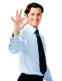 Businessman assures everything is 'OK'. Confident, happy businessman shows the 'OK' hand sign for a successful day Royalty Free Stock Photo