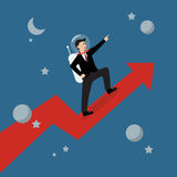 Businessman astronaut standing on a growing graph Stock Photo