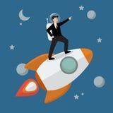 Businessman Astronaut Standing On A Rocket Stock Photo