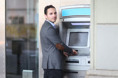 Businessman at the ATM Royalty Free Stock Images