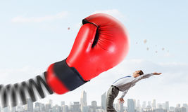 Businessman attacked by glove Royalty Free Stock Image