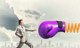 Businessman attacked by glove Royalty Free Stock Photo