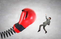 Businessman attacked by glove Royalty Free Stock Photography