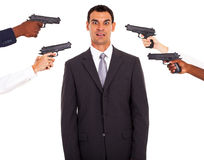 Businessman attacked gun. Businessman being attacked at gun point by colleagues Stock Photos