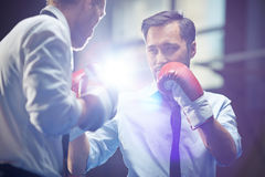 Businessman attacking rival Stock Photo