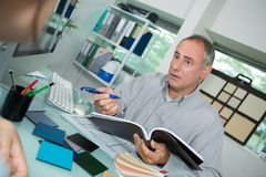 Businessman attending client in office stock photos