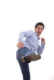 Businessman with an attitude in fight position with a kick Stock Photography