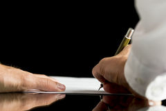 Businessman or attorney  signing a document,  contract or legal Stock Photo
