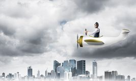 Businessman in aviator hat driving paper plane royalty free stock images