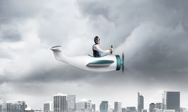 Businessman in aviator hat driving paper plane royalty free stock photos