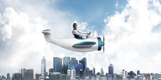 Businessman in aviator hat and goggles. Driving propeller plane above downtown with high modern buildings. Funny man having fun in small airplane. Blue sky stock illustration