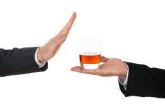 Businessman avoiding alcohol Royalty Free Stock Photo