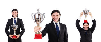 The businessman awarded with prize cup on white. Businessman awarded with prize cup on white royalty free stock photos