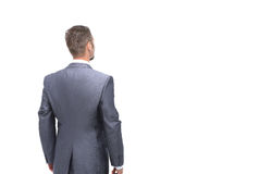 Businessman from the back - looking at something over a white ba Royalty Free Stock Image