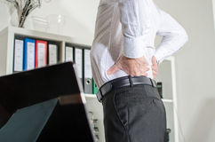 Businessman with back pain Royalty Free Stock Images