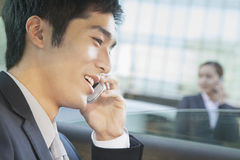 Businessman in Back Seat of Car on the Phone, Close Up Royalty Free Stock Image