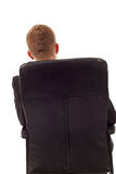 Businessman back seated. On an office chair looking to the copy space royalty free stock photography
