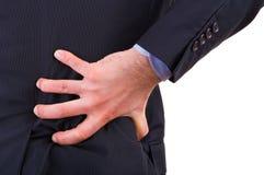 Businessman with backache. Stock Photos