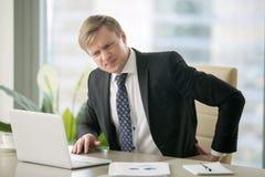 Businessman with backache Stock Photos