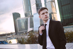Businessman on background of the business center stock photography