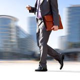 Businessman on the background of the office. Royalty Free Stock Image