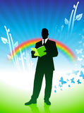 Businessman on background with rainbow Royalty Free Stock Images