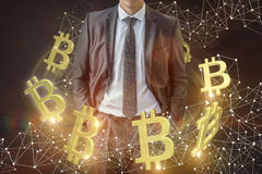 Businessman on the background of the turnover of bitcoins. stock photo