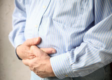 Businessman with bad stomach pain Royalty Free Stock Photography