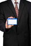 Businessman with a badge Royalty Free Stock Photos