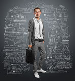 Businessman with bag Stock Image