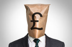 Businessman with a bag on the head - with pound sign Stock Images