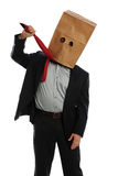 Businessman with Bag on Head Pulling Necktie Royalty Free Stock Photos