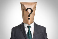 Businessman with a bag on the head - with question mark Royalty Free Stock Image