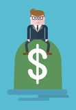 Businessman_on_bag_of_money 库存照片