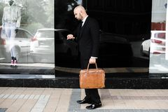 Businessman with a brown bag near the office royalty free stock photo
