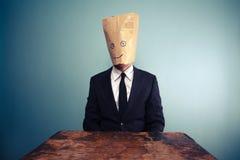 Businessman with bag over head Stock Photos