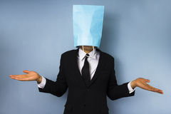 Businessman with bag over his head. Doesn't know what to do Stock Photos
