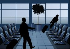 Businessman with baggage silhouette in airport Stock Images