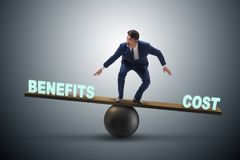 Free Businessman Balancing Between Cost And Benefit In Business Conce Stock Photo - 103963310