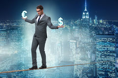 The businessman balancing between choosing dollar and euro Royalty Free Stock Images