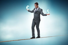 The businessman balancing between choosing dollar and euro Stock Photography