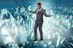 The businessman balancing between choosing dollar and euro Royalty Free Stock Photos