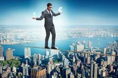 The businessman balancing between choosing dollar and euro Royalty Free Stock Photography