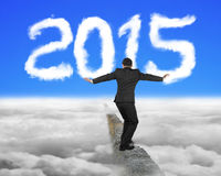 Businessman balancing on concrete ridge with white 2015 shape cl Stock Photos