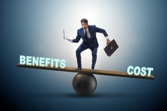 Businessman balancing between cost and benefit in business conce Royalty Free Stock Image
