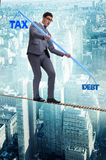 The businessman balancing between debt and tax Royalty Free Stock Photography