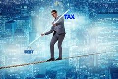 The businessman balancing between debt and tax Royalty Free Stock Photo