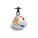 Businessman balancing on dice of dollar sign Royalty Free Stock Images