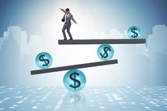 The businessman balancing in financial dollar concept Stock Photo